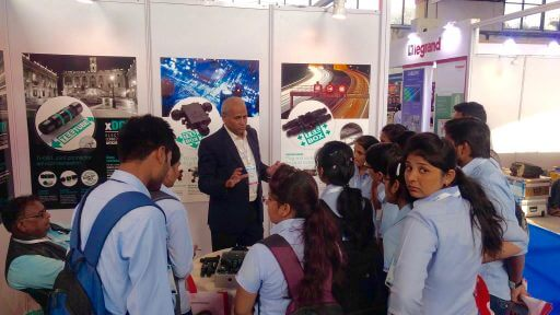 Mr. Omprakash Todi explaining the use of Techno waterproof connectors with students at CEEAMATECH 2017.